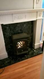 Cast iron fire with white wood surround
