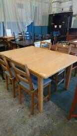 oak effect dining table with four chairs ( tie on denim cushions ) - Delivery Available