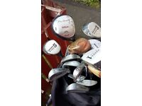 Set of golf clubs, 4 Woods, golf balls and sturdy zip over bag