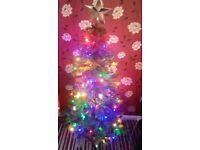 brand new 5 ft green Christmas tree with lights