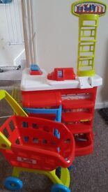 Toy shop and shopping trolley