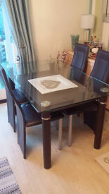 Glass Table with undershelf and 4 brown faux leather Chairs