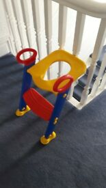 Child's toilet seat with steps