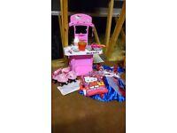 Hello Kitty bundle: plastic kitchen + utensils, quad skates, secret pillow, 2 purses, dress up dress