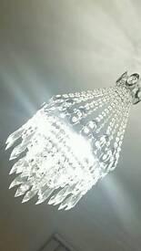 2 glass chandeliers