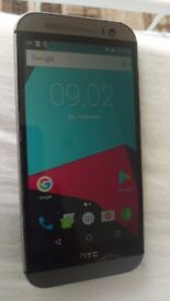 Htc one m8 unlocked the phone is rooted and has lineage0s sofware installed screen looks new back