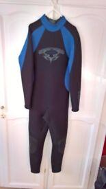 Tiki wetsuit adult size medium, as new hardly worn. 5mm neoprene body & legs, 3mm neoprene on arms.