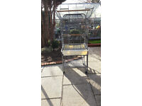 Large Parrot cage good condition slight damage to tray.