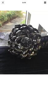 Large round flower filled cushion , black and silver