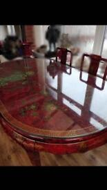 Chinese/Oriental Red Lacquered Dining Table And Chairs, Display Cabinet And Large Vase