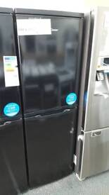 New graded Candy 55cm fridge freezer with 12 months guarantee