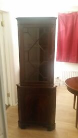 Tall corner cabinet with glass display