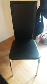 4 high backed chairs in a black pu leather fabric