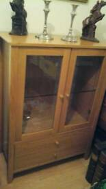 Display cabinet with two draws