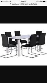 6 chairs and table black and white