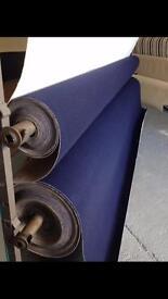 2 rolls of blue carpet