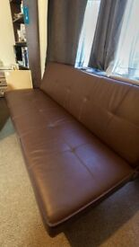 Brown sofa. The sofa can be extended for sleeping.