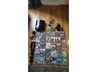 Ps3 console 120gb 32 games plus move controllers