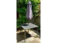 Garden table and parasol with weighted base £40 ono, collection