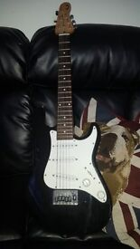 BARGAIN, ELECTRIC KIDS GUITAR FROM JONH LEWIS, ONLY 35 POUNDS