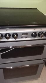 A second hand New world gas cooker good working order 60 cm wide.