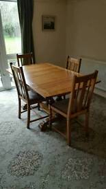 Light oak extending table with 4 chairs possibly art decor 1950s