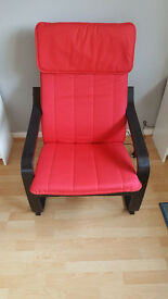 two brand new black and red Poang chairs