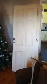 3 white wooden doors
