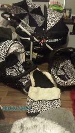 3 in 1 matrix leopard print pram with accessories.