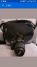 Nikon D3100 camara and bag (no charger)