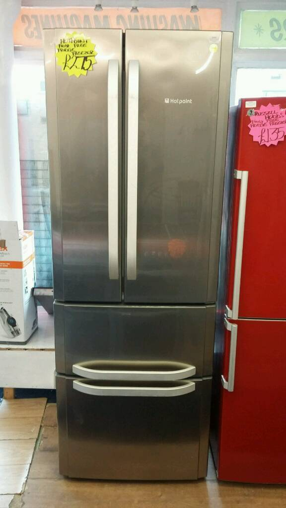 HOTPOINT STAINLESS STEEL FROST FREE HALF AND HALF QUTRO STYLE FRIDGE FREEZER