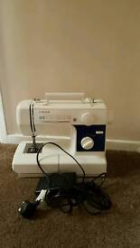 Singer Sewing Machine. About 20yrs old. In working order. May need a service.