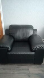 Black leather three seater sofa and chair and large foot stool
