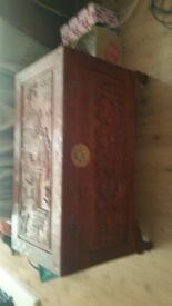 Very large oriental style carved wooden chest