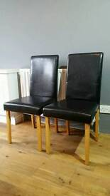 Table and 4 leather substitute chairs