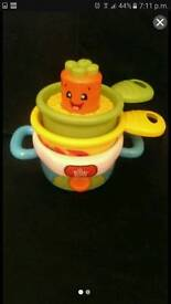 Bright starts giggle and stack pots pans