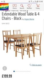 Brand new dining table and chairs in box