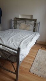 Silver metal posts double bed