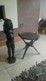 African statue and table