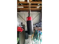 Britannia boxing punch bag and a set of Lonsdale boxing gloves