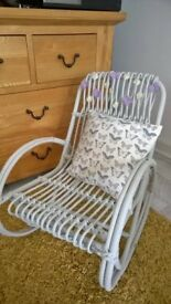 children refurbished rocking chair with pretty small cushion with sewn on daisy flowers