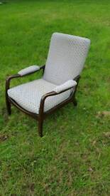 Vintage easy chair with padded arms high backed lounger