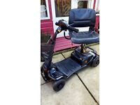 mobility scooter ultralite 480 carrys 18 stone 12 miles to charge as new