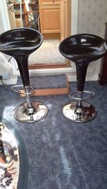 TWO BLACK ADJUSTABLE BAR STOOLS IN PVC WITH CHROME STEM AND FOOTREST