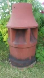 Tall, clay chimney pot.