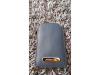 Michael Kors phone holder royal navy colour, saffiano leather, yellow logo at the front