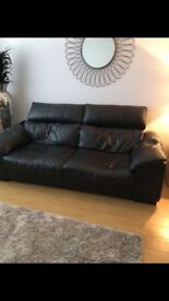 DFS Black leather 3 and 2 seater with footstool