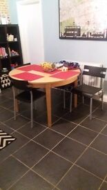 Ikea Round Extendable Dining Table and Four Chairs