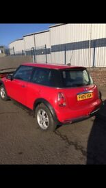 Mini red hatchback