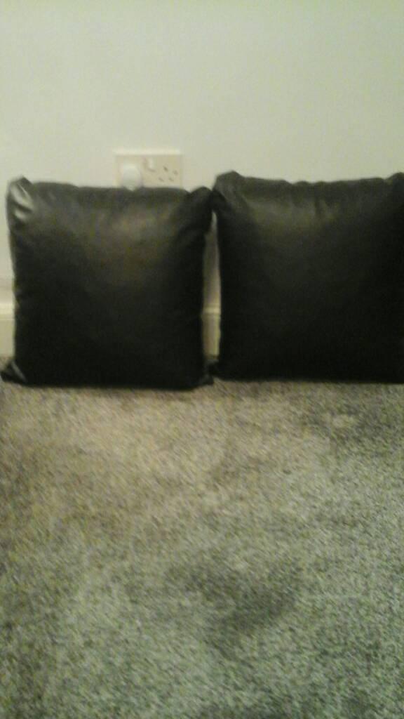 2 black leather cushions